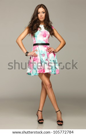 Full length of beautiful female posing in summer dress - stock photo