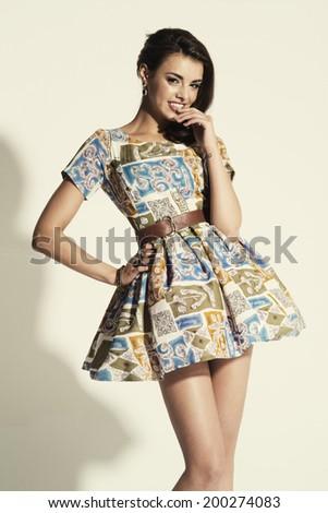 Full length of beautiful female posing in summer dress.