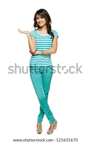 Full length of beautiful  woman showing / holding on the palm blank copy space over white background