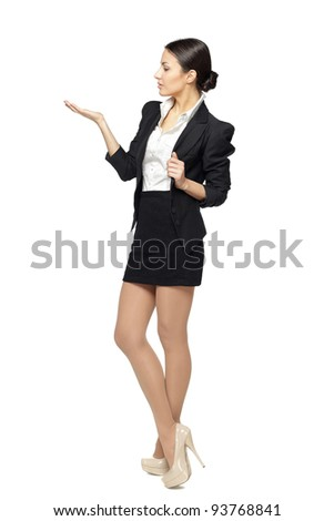 Full length of business woman looking at blank copy space on her palm - empty space for product or text, isolated on white background