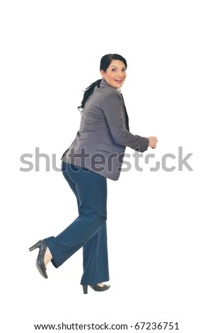 Full length of business woman running  from something and looking back with a surprised happy face isolated on white background
