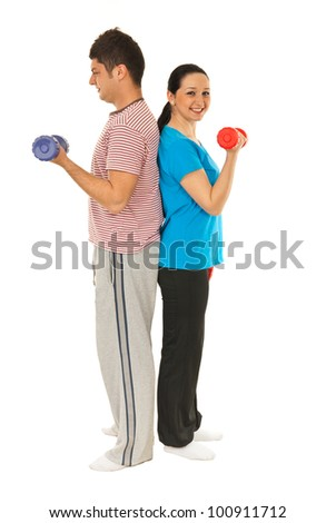 Full length of couple workout with dumbbell isolated on white background