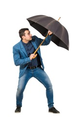 Full length of determined businessman hiding behind his open umbrella as a shield to protect of any danger isolated on white background. Business concept of facing adversity and auto defending.