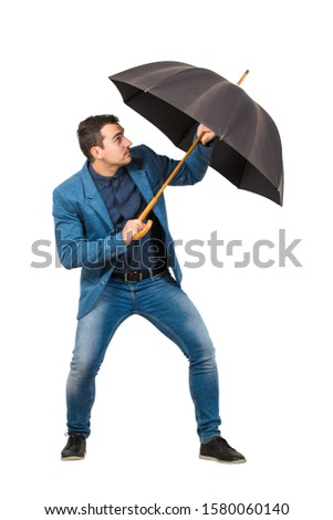 Full length of determined businessman hiding behind his open umbrella as a shield to protect of any danger isolated on white background. Business concept of facing adversity and auto defending. Foto d'archivio ©