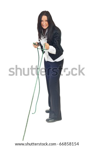 Full length of executive woman pulling rope isolated on white background