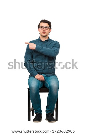 Full length of fink guy informer pointing index finger aside, blaming someone as guilty or choosing something, isolated on white background. Frustrated nerd, business worker snitch wears glasses. Stock photo ©