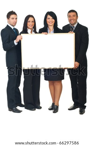 Full length of four business people in a row holding a blank banner isolated on white background