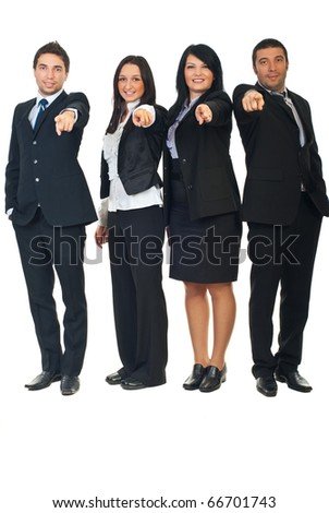 Full length of four business people in a row pointing  and chosen you to join their business isolated on white background