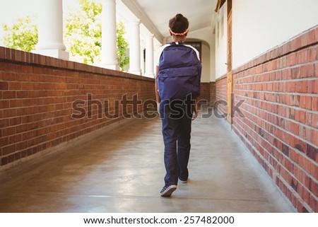 Full length of girl walking in school corridor