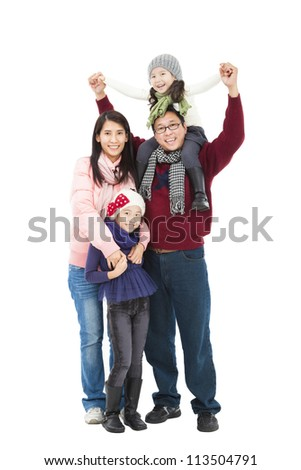 full length of happy asian family in winter clothes standing together and isolated on white