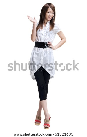Full length of happy cheerful beautiful Japanese Asian young woman holding her hand out and showing copy space for your product.