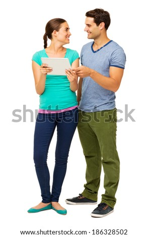 Full length of happy loving couple using tablet PC isolated over white background. Vertical shot.
