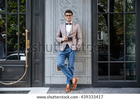 full length of happy young man...
