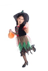 Full length of little asian girl in witch costume with make up standing over white background. Child Halloween costume concept.