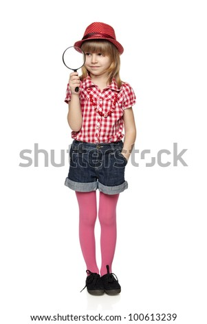 Full length of little girl with magnifying glass, isolated on a white background