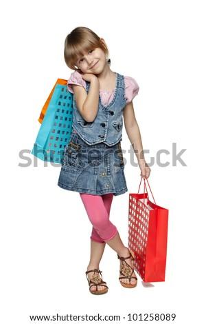 Full length of little girl with shopping bags over white