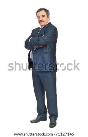 Full length of mature elegant business man standing with arms folded isolated on white background