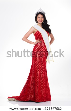Full Length of Miss Pageant Contest in Asian Red Sequin Evening Ball Gown dress with Silver Diamond Crown Sash, fashion make up face hair style, studio lighting white background isolated copy space #1391597582