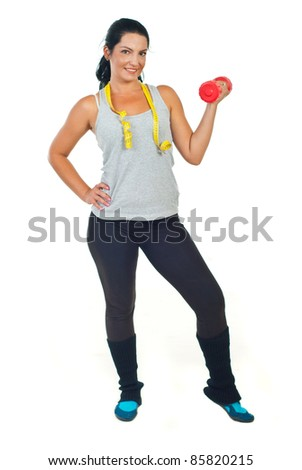 Full length of slim woman with centimeter holding barbell isolated on white background