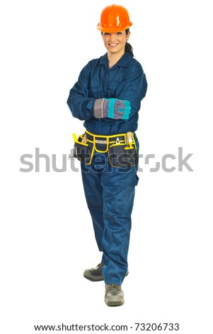 Full length of smiling constructor worker woman standing with hands crossed isolated on white background