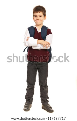 Full length of student boy at primary school with back bag standing  with arms folded isolated on white background