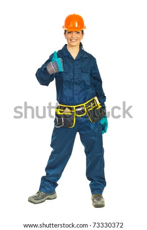 Full length of successful constructor worker woman giving thumb up isolated on white background
