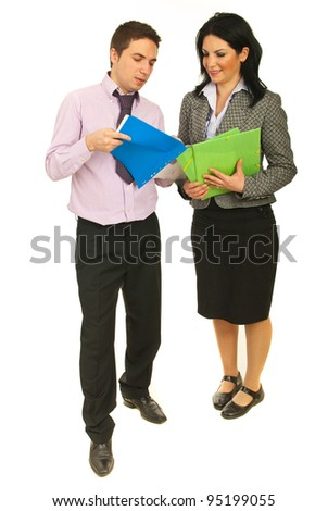 Full length of two business people looking on contracts and having conversation isolated on white background