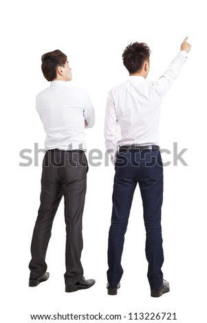 full length of two businessman pointing and looking
