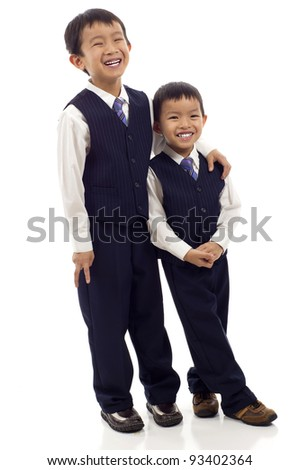 Full length of two happy Asian brothers isolated over white background