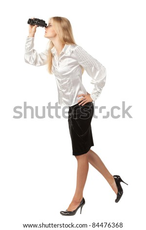 Full length of young beautiful businesswoman looking through binocular in distance over white background, side view