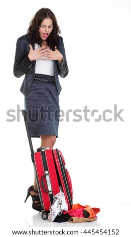 Full length of young business woman to late mishap misadventure pulling red travel bag clock isolated on white background #445454152