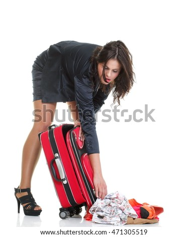 Full length of young business woman to late mishap misadventure pulling red travel bag clock isolated on white background #471305519