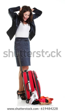 Full length of young business woman to late mishap misadventure pulling red travel bag clock isolated on white background #619484228