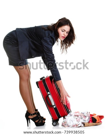 Full length of young business woman to late mishap misadventure pulling red travel bag clock isolated on white background #739938505