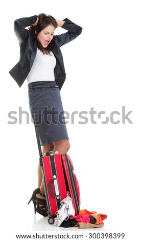 Full length of young business woman to late mishap misadventure pulling red travel bag isolated on white background #300398399