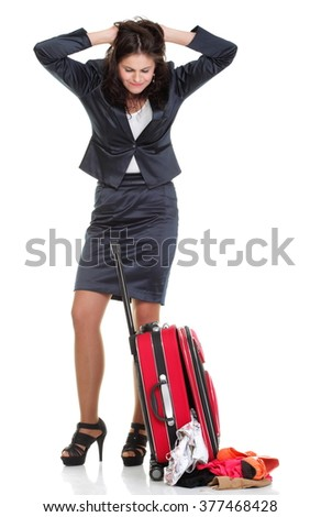 Full length of young business woman to late mishap misadventure pulling red travel bag isolated on white background #377468428