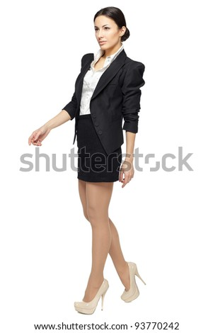 Full length of young business woman walking isolated on white