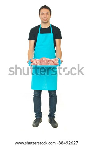 Full length of young butcher holding raw meat isolated on white background