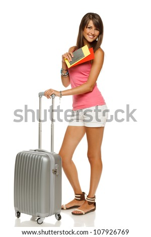 Full length of young female in casual standing with travel bag, holding passport and tickets, isolated on white background