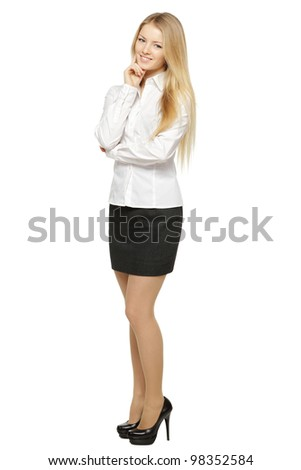 Full length of young smiling female standing with folded hands, isolated on white background