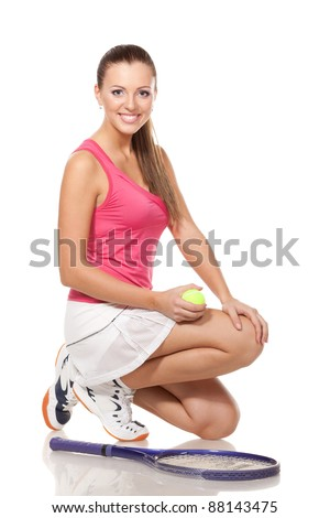 Full length of young tennis woman sitting in the squatting position, on white background