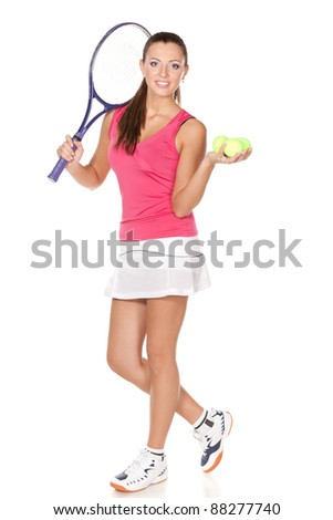 Full length of young woman holding racket and ball isolated on white background