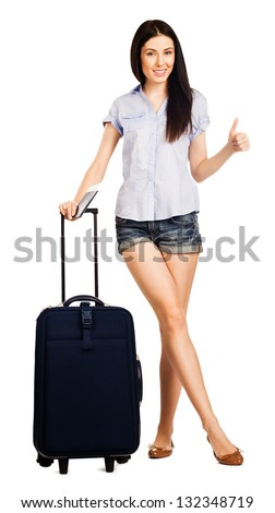 Full length of young woman showing okay with a travel bag, isolated on white background