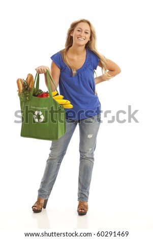 Full length of young woman with green recycled grocery bag