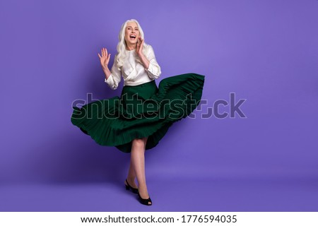 Full length photo candid charming old woman enjoy her rest relax skirt fly wind she laugh feel rejoice wear good look clothes footwear kitten heels isolated vibrant color background