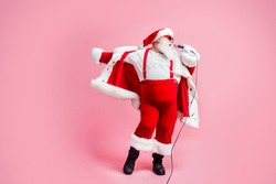Full length photo crazy fat white grey hair beard santa claus big belly sing mic song enjoy x-mas christmas jolly party wear sunglass hat suspenders boots isolated pastel color background