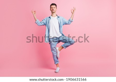 Full length photo of calm peaceful man make om sign weekend rest isolated on pastel pink color background