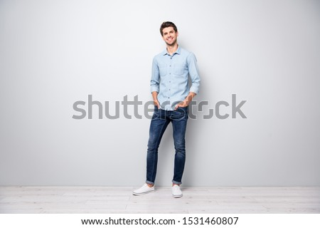 Full length photo of charming attractive guy from university college put hands in pockets stand listen true rich wealthy macho attract girls wear stylish white clothes isolated grey color background
