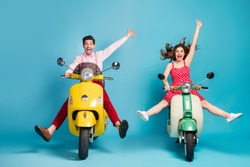 Full length photo of crazy lady guy couple drive two retro moped travelers traffic jam easy way spread legs raise arms rejoicing formalwear vintage clothes isolated blue color background
