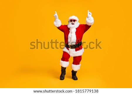 Full length photo of crazy santa claus with grey beard listen wireless modern headset x-mas christmas music dance party wear sunglass cap isolated bright shine color background